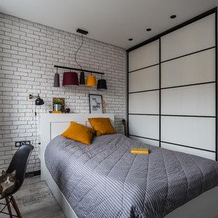 Стильный дизайн: спальня среднего размера в современном стиле с белыми стенами, паркетным полом среднего тона и серым полом - последний тренд
