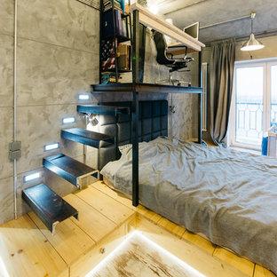 Modelo de dormitorio principal, industrial, con paredes grises