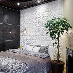 Новые идеи обустройства дома: хозяйская спальня в современном стиле с белыми стенами, паркетным полом среднего тона, стандартным камином и фасадом камина из плитки