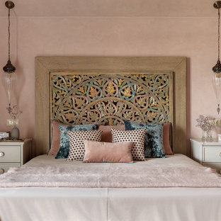 This is an example of a mediterranean master bedroom in Moscow with pink walls and no fireplace.