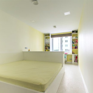 Inspiration for a small contemporary master cork floor and white floor bedroom remodel in Yekaterinburg with yellow walls