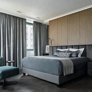 На фото: хозяйская спальня в современном стиле с серым полом и панелями на стенах с