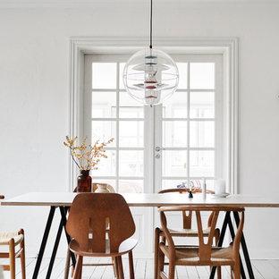 Imagen de comedor nórdico, de tamaño medio, cerrado, sin chimenea, con paredes blancas, suelo de madera pintada y suelo blanco