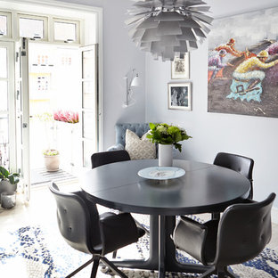 Mid-sized danish dining room photo in Wiltshire with purple walls