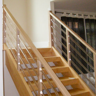 Example of a mid-sized minimalist wooden u-shaped glass railing staircase design in DC Metro