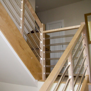 Inspiration for a mid-sized modern wooden u-shaped glass railing staircase remodel in DC Metro
