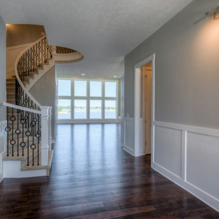 Staircase - modern curved mixed material railing staircase idea in Omaha