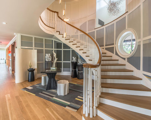 Example Of A Coastal Wooden Curved Wood Railing Staircase Design In New York