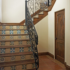 mediterranean staircase by Vanguard Studio Inc.
