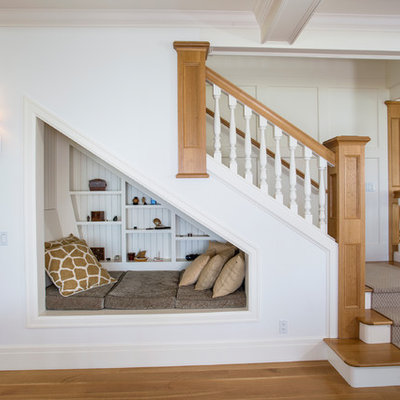 Mid-sized beach style wooden l-shaped staircase photo in Seattle with painted risers