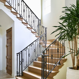Example of a mid-sized tuscan wooden u-shaped metal railing staircase design in Los Angeles with wooden risers