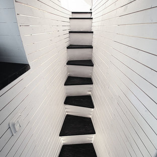 Example of a small trendy painted straight staircase design in Gothenburg with painted risers