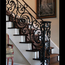 Traditional Staircase by BO CREATIVE STEEL INC.