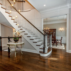 Traditional Staircase by Heritage Luxury Builders