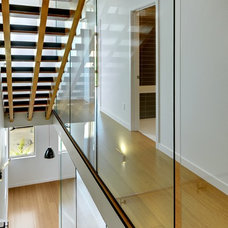 Contemporary Staircase by Malboeuf Bowie Architecture