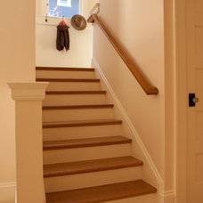 Traditional Staircase by MkM Architecture Inc