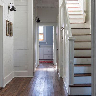 Example of a mid-sized country wooden straight wood railing staircase design in Austin with painted risers