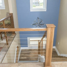 Beach Style Staircase by Tab Winborne Corporation