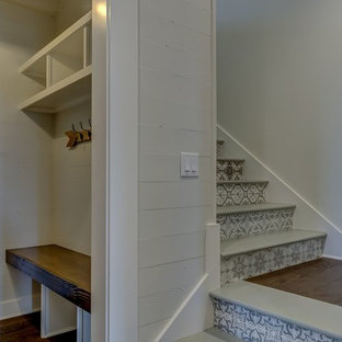 Inspiration for a country painted l-shaped staircase remodel in Other with tile risers