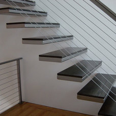 Contemporary Staircase by One Off Furniture,LLC