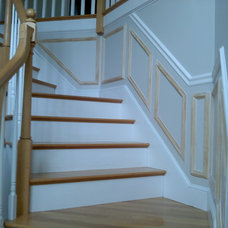 Traditional Staircase by L & J Building and Remodeling Inc.