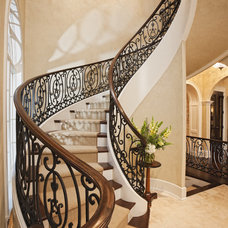 Traditional Staircase by Eskuche Design