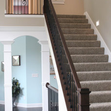 Traditional Staircase by Otero Signature Homes