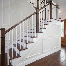 Farmhouse Staircase by Keesee and Associates, Inc.