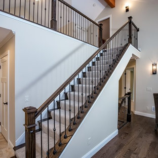Staircase - mid-sized transitional carpeted straight staircase idea in Minneapolis with carpeted risers