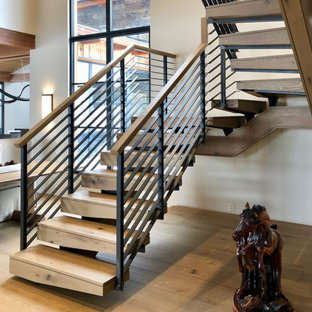 Inspiration for a wooden u-shaped mixed material railing staircase remodel in Cleveland with wooden risers