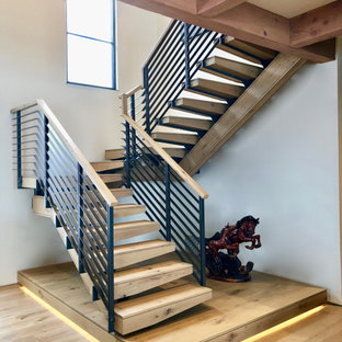 Inspiration for a wooden u-shaped mixed material railing staircase remodel with wooden risers
