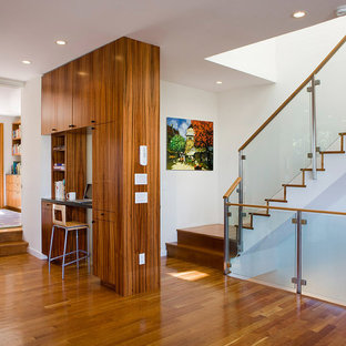 Trendy wooden glass railing staircase photo in San Francisco with wooden risers