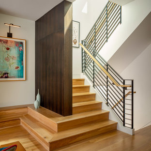 Example of a large 1950s wooden u-shaped cable railing staircase design in San Francisco with wooden risers