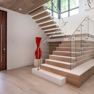 Staircase - contemporary floating glass railing staircase idea in Orlando