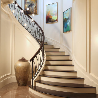 Transitional wooden curved mixed material railing staircase photo in Miami with painted risers