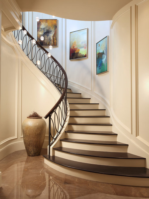 Transitional Wooden Curved Metal Railing Staircase Photo In Miami