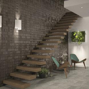 Imagen de escalera suspendida, actual, sin contrahuella, con escalones de madera