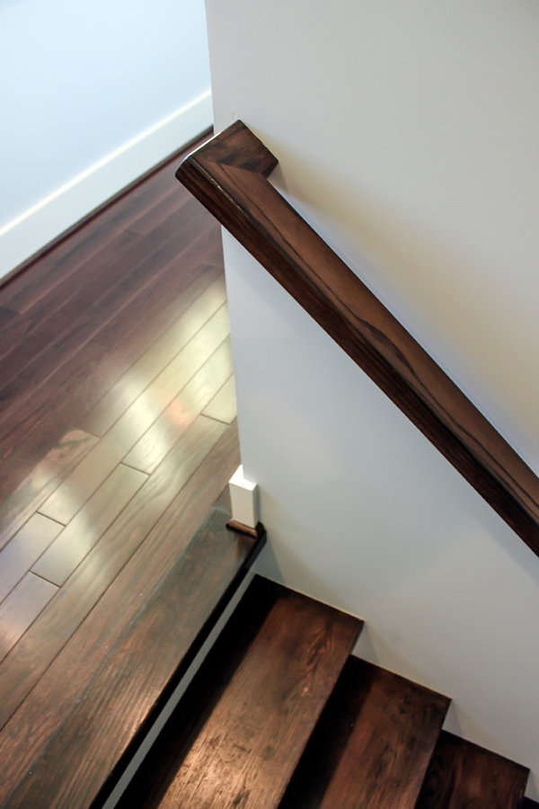 Light and Open Wooden & Horizontal Stainless Steel Staircase System in Residenti