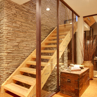 Contemporary wood staircase in Calgary with open risers.