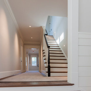 Photo of a large shabby-chic style wood straight wood railing staircase in DC Metro with wood risers.
