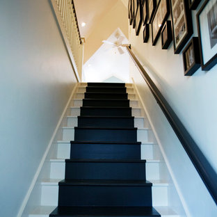 Example of a mid-sized eclectic painted straight staircase design in Atlanta with painted risers