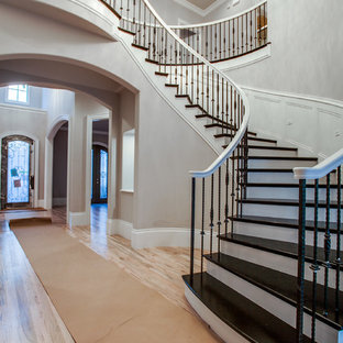 Elegant painted curved staircase photo in Dallas with painted risers
