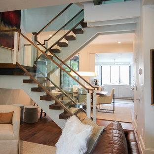 Idéer för mycket stora funkis flytande trappor i glas, med öppna sättsteg och räcke i glas