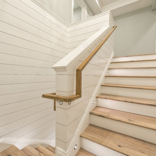 Inspiration for a mid-sized wooden u-shaped wood railing staircase remodel with wooden risers