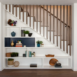 Example of a transitional wooden straight wood railing staircase design in Los Angeles with painted risers