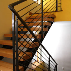 Modern Staircase by Pinnacle Mountain Homes