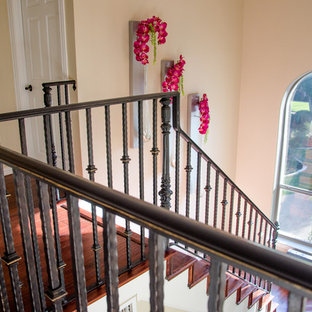 Inspiration for a mediterranean wooden l-shaped staircase remodel in Dallas with wooden risers