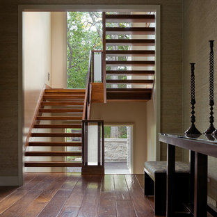 Trendy wooden u-shaped open staircase photo in Chicago