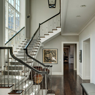 Inspiration for a timeless wooden staircase remodel in Chicago with painted risers
