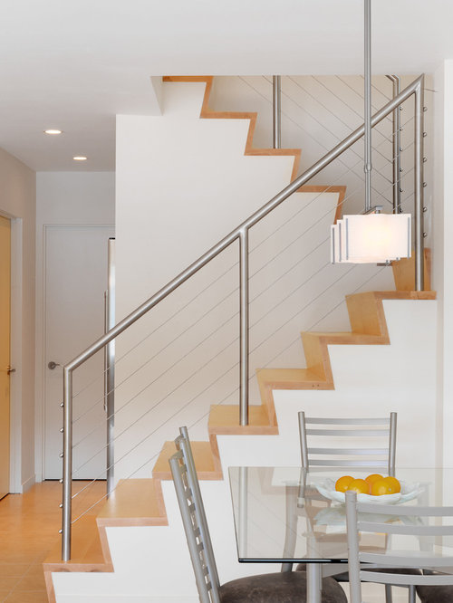 Example Of A Trendy Wooden U Shaped Staircase Design In Burlington